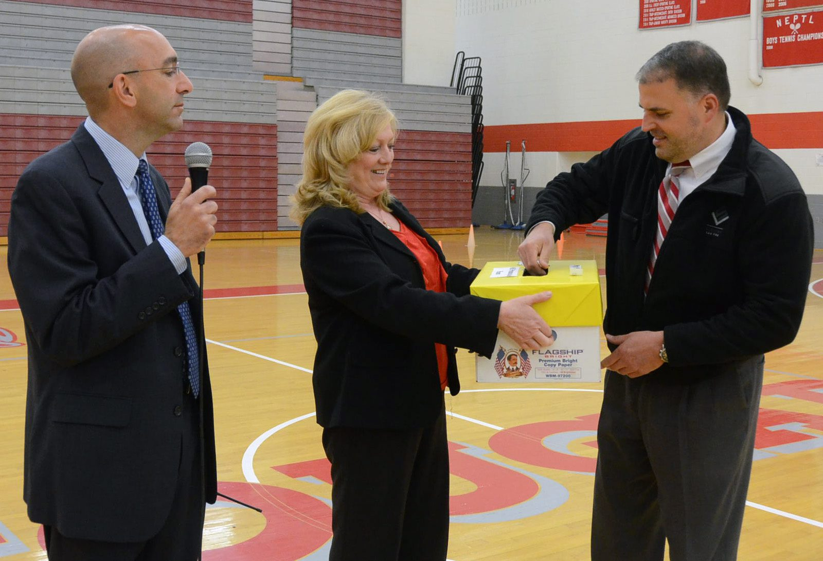 Attorney Christopher Slusser picks a winning name during the Hazleton Area School District's Prom Promise assembly.